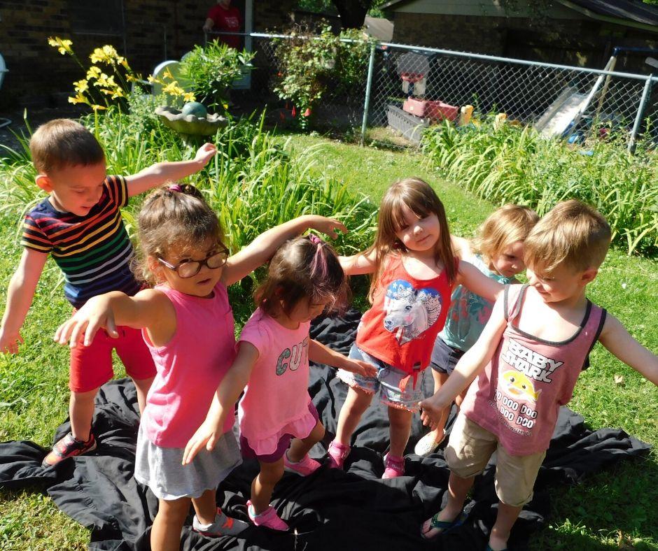 kids doing garden yoga