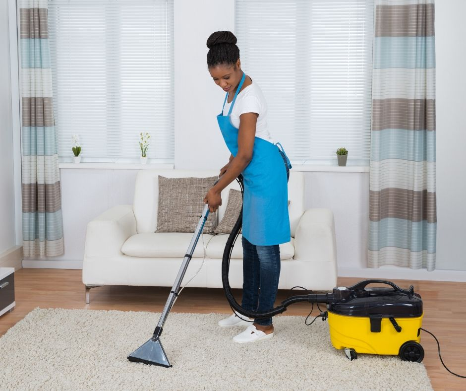 home daycare provider vacuuming floors keeping up with the mess