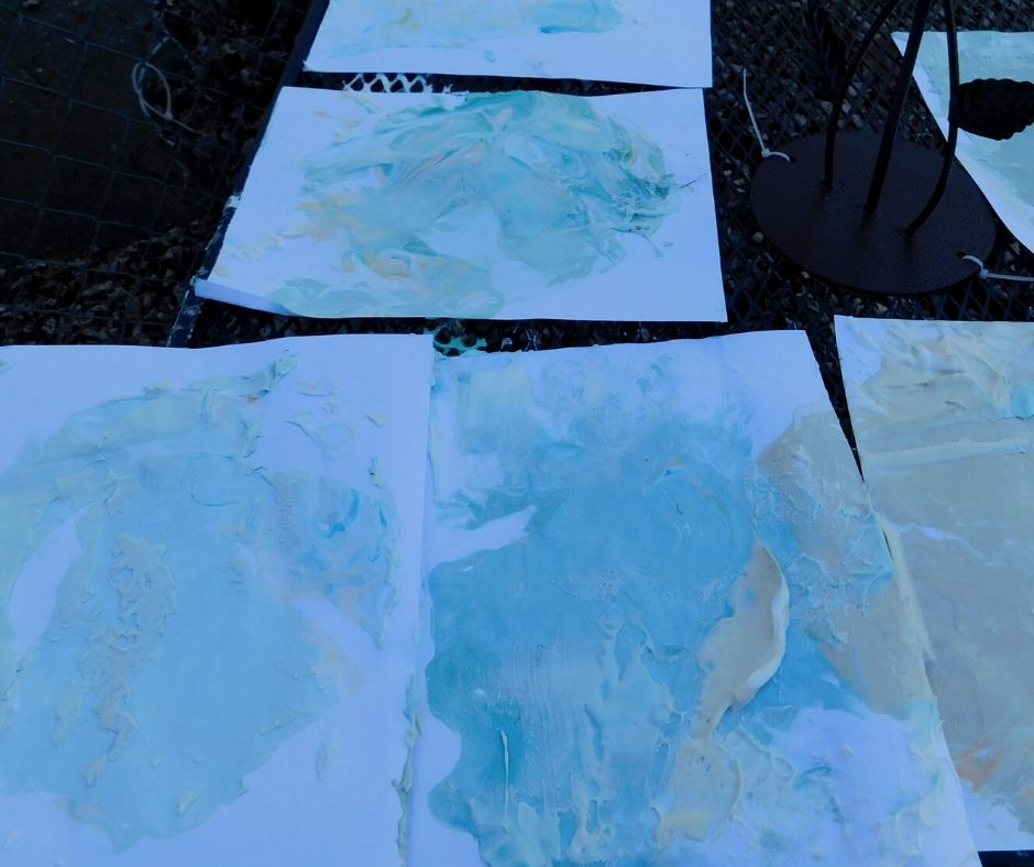shaving cream paintings on a table