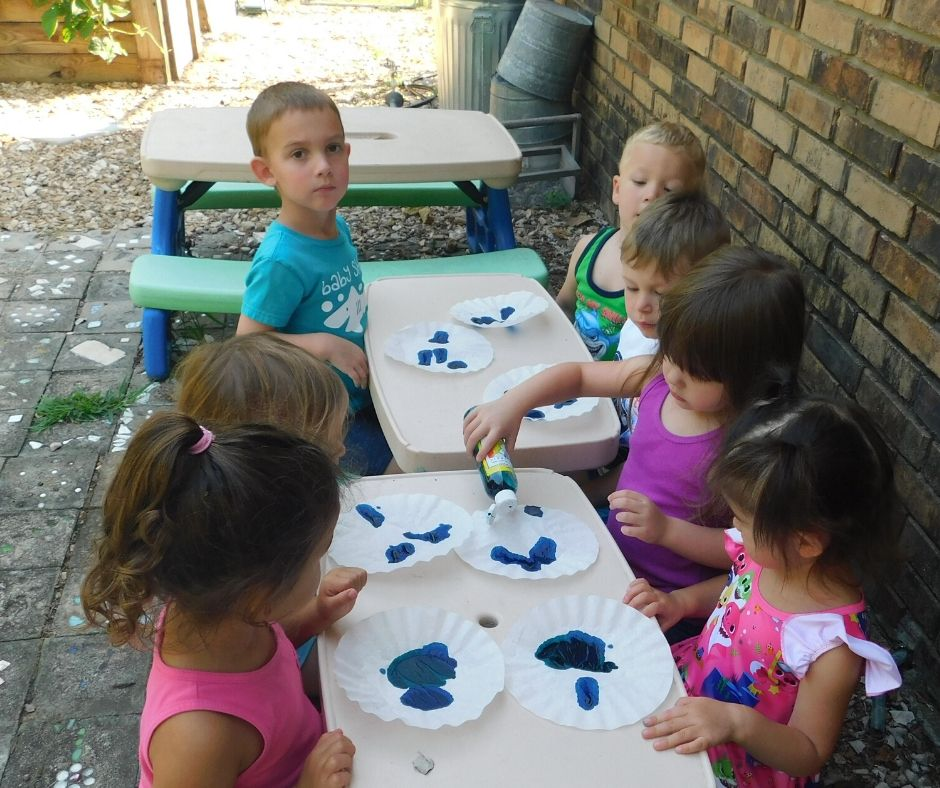 kids painting coffee filters