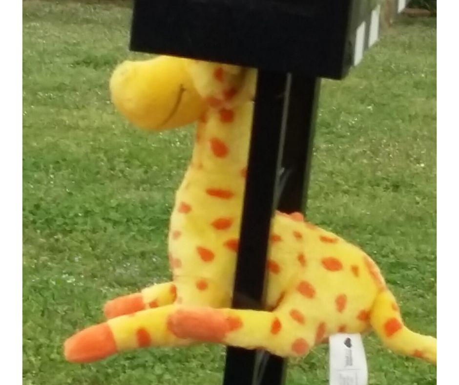 Stuffed garaffe hanging on mailbox for scavenger hunt