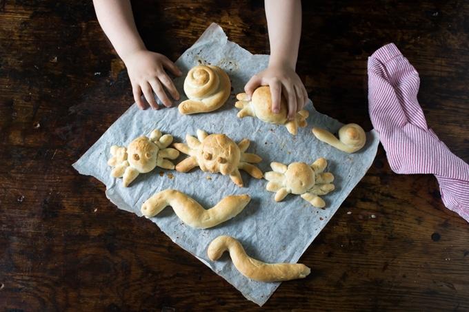 child holding a bread sea creature make of bread