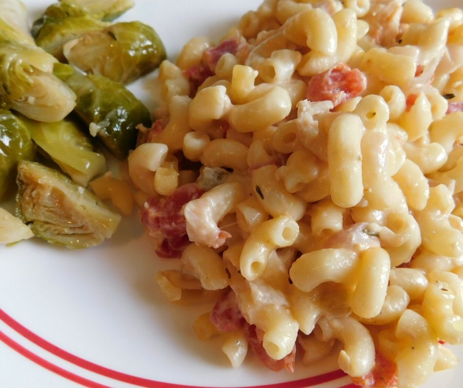creamy tuna macaroni casserole spicy scooped on a plate with brussel sprouts.