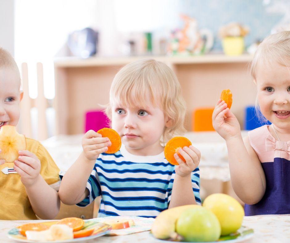 kids eating plates of food at daycare menu, oranges