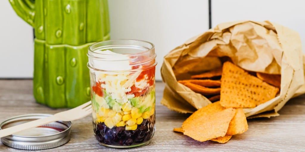 vegetable and bean nachos in a mason jar
