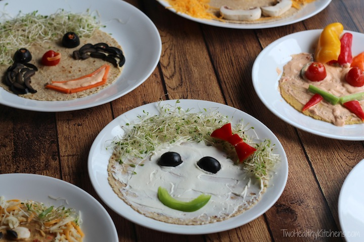 tortillas with cream cheese and then vegetables in the shapes of face parts