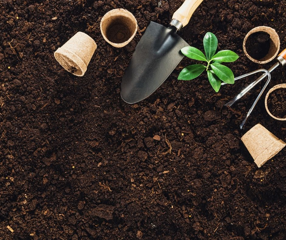 gardening pots, soil, and tools with plants for oklahoma growing zones