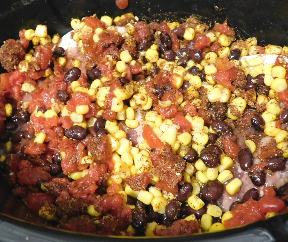 corn, rotel, and black beans on pork chops in the crock pot