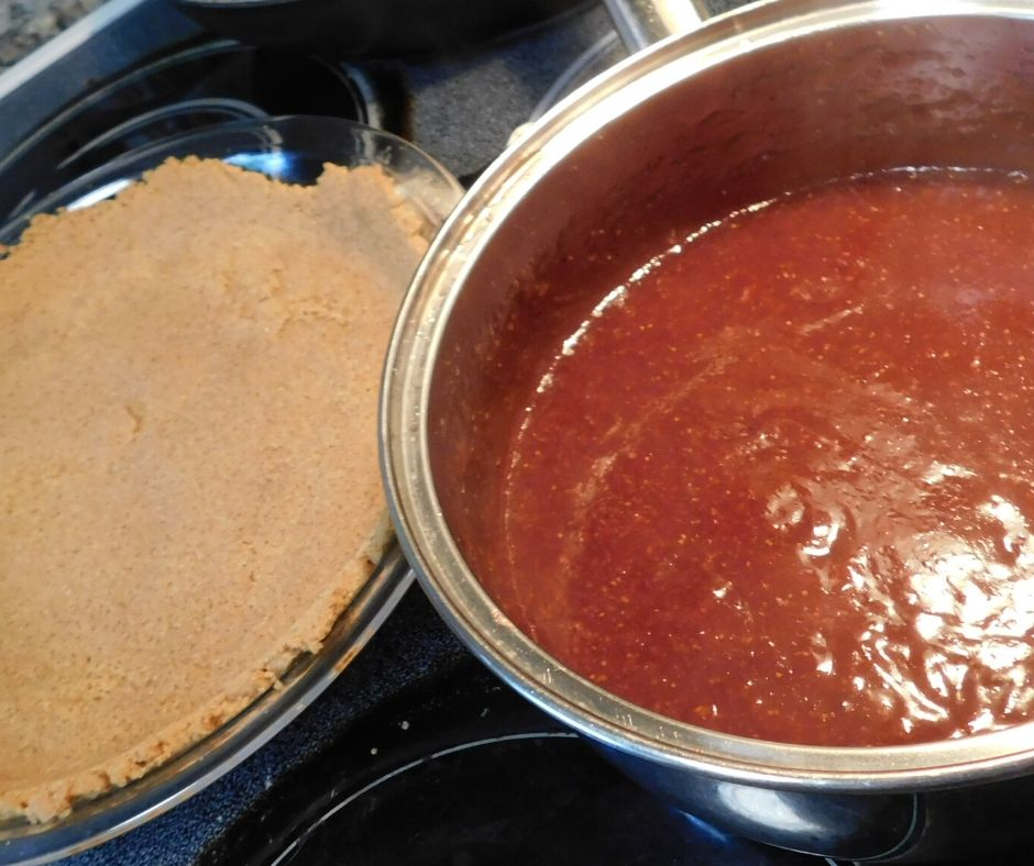 graham cracker crust and pie filling on the stove top