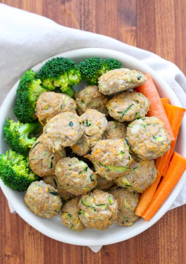 Turkey and sweet potato bies on a plate with broccoli and carrots