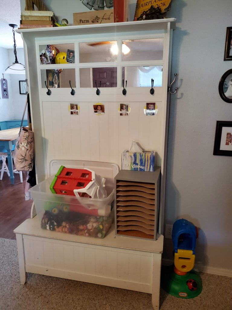 welcome area and jacket and paper storage in small home daycare setup