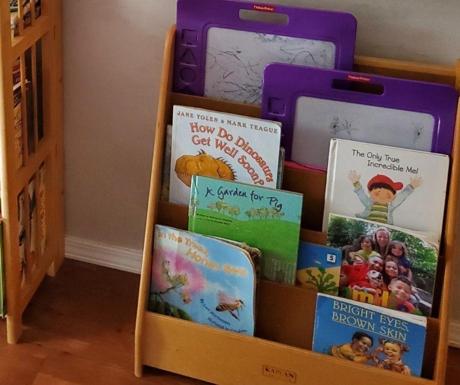 book rack full of preschool books in home daycare