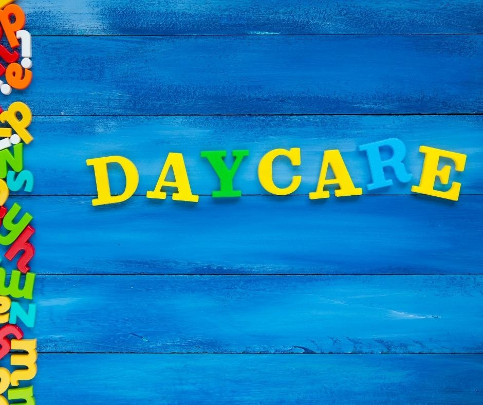 daycare sign, blue wood with plastic magnetic letters