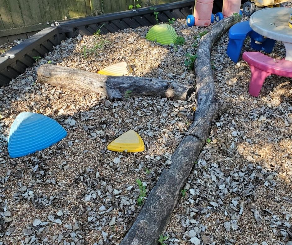 natural playscape, large tree branches for balance beam