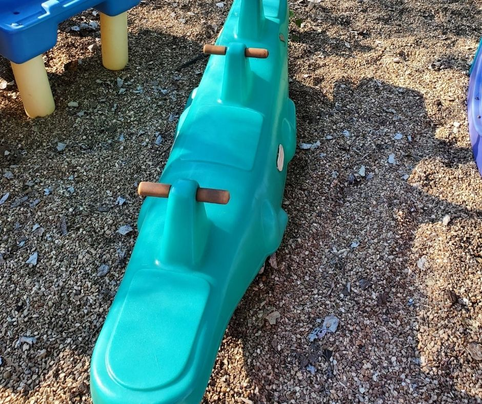 alligator teeter totter on home daycare playground