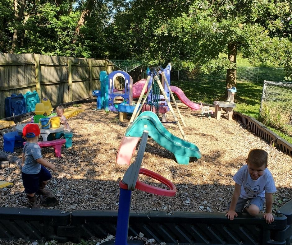 home daycare playground with swing set, climbers, slides, and other toys