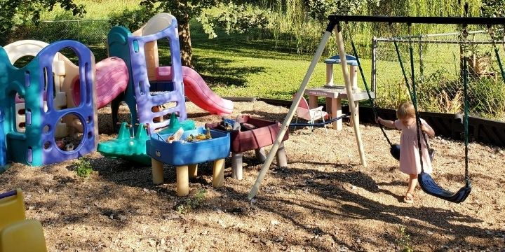People ask all the time to see my outdoor space. Setting up my home daycare playground took me a few years, but we love playing on it!