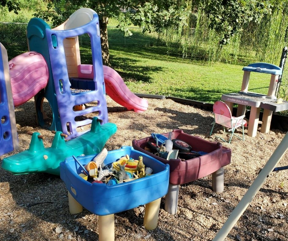 home daycare playground with climbers and toys