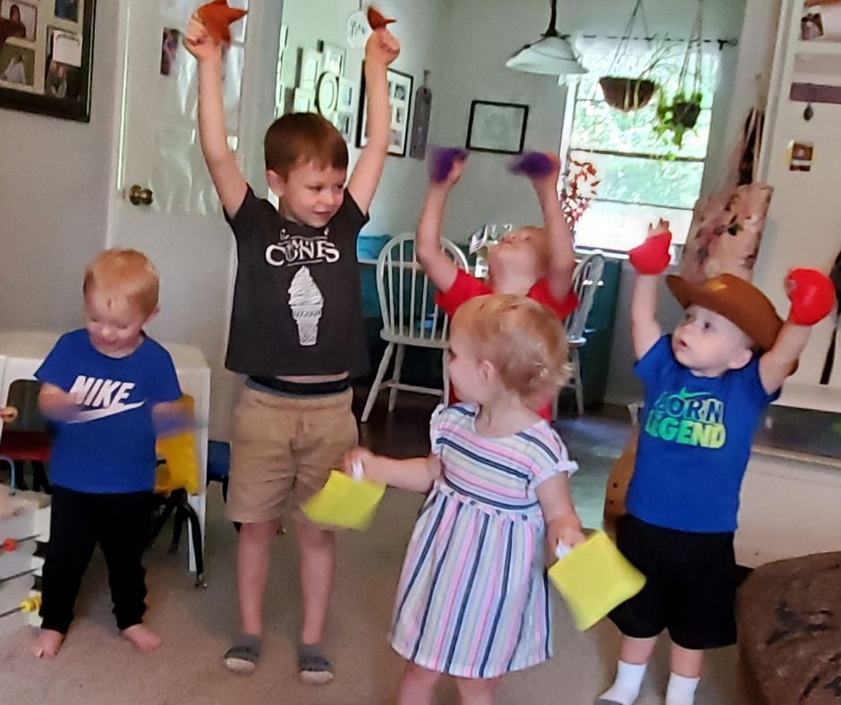 kids playing with shape bean bags in home daycare