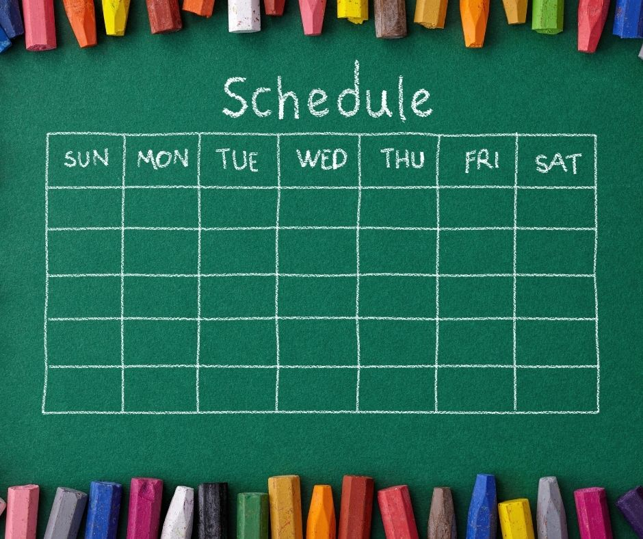 chalk board schedule with crayons all aroud the outside