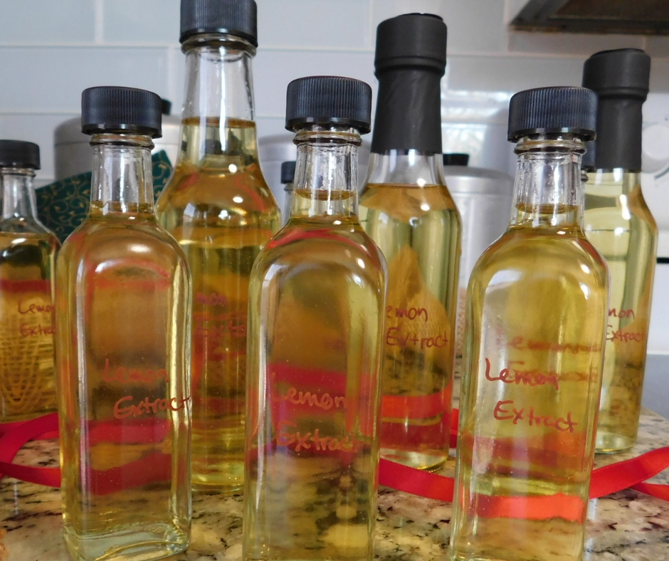 bottles of homemade lemon extract on the counter