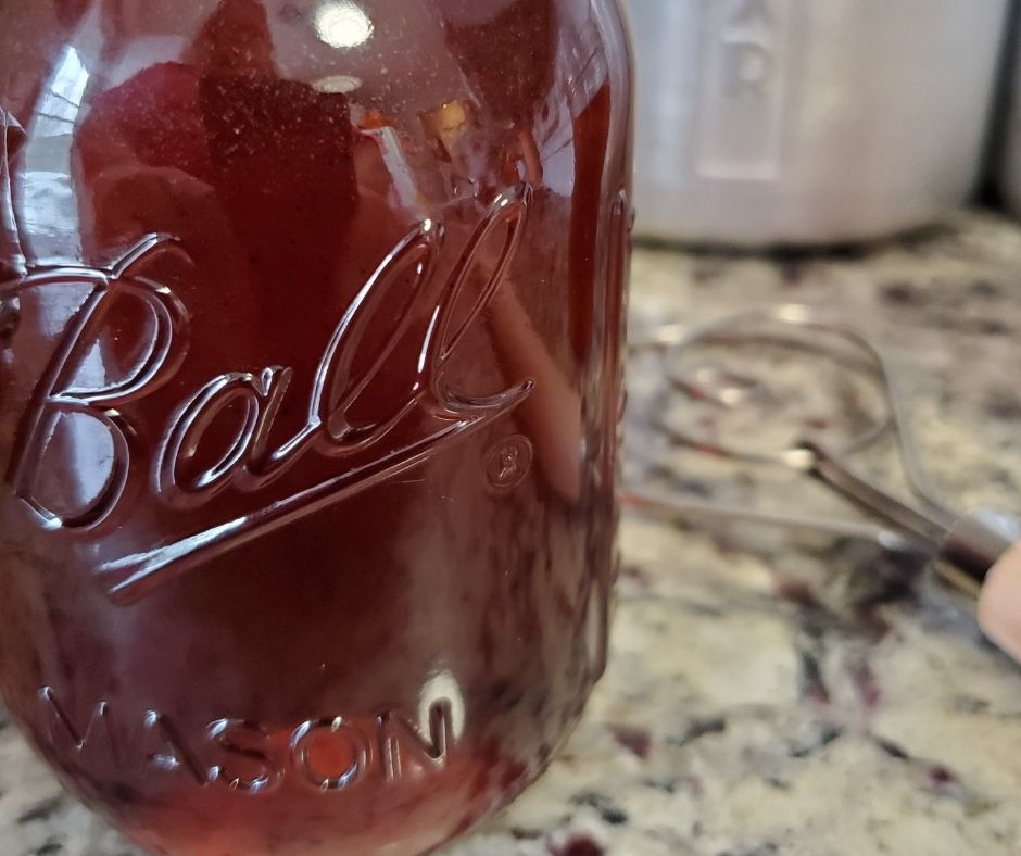 jar of homemada vanilla syrup on the counter