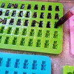 organic elderberry gummies going into silicone molds with droppers