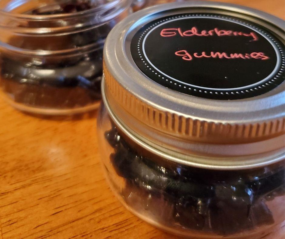 organic elderberry gummies in a small mason jar on the table