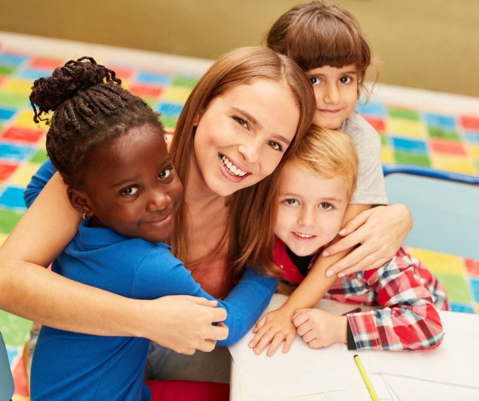 daycare provider with kids hugging