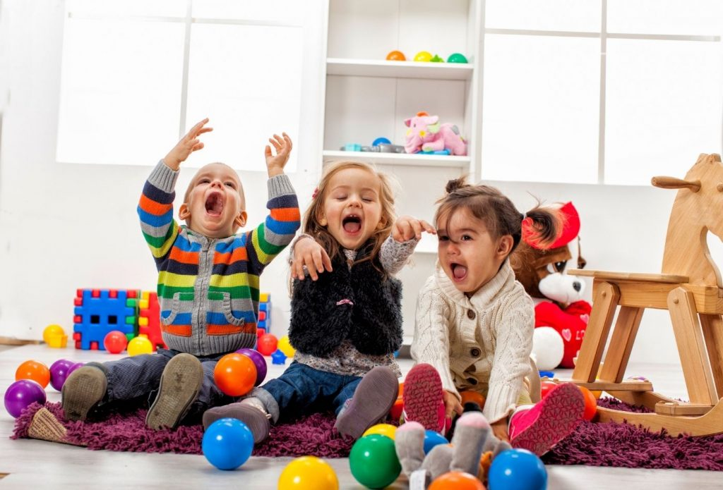 Kids laughing and playing in home daycare