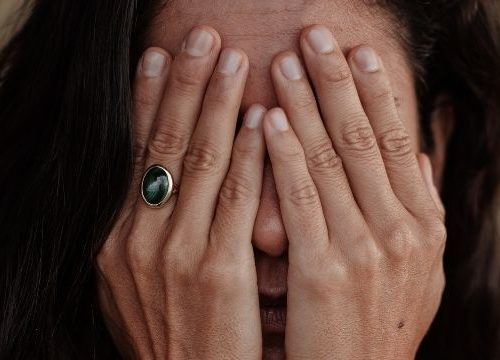 Woman covering her hands in frustration