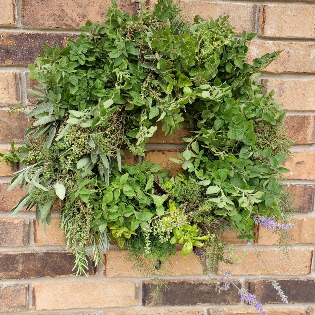 herb wreath hanging on a brick wall