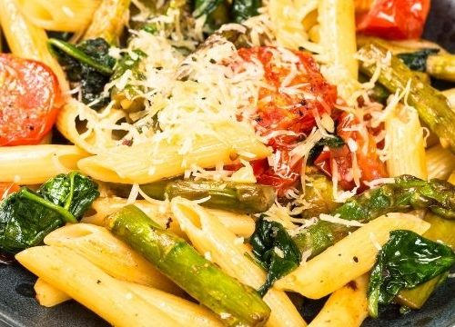 Meatless Pasta dinner with fresh vegetables and grated cheese