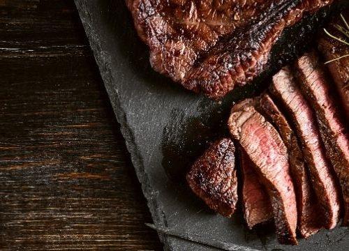 Air fryer beef steak sliced on a board