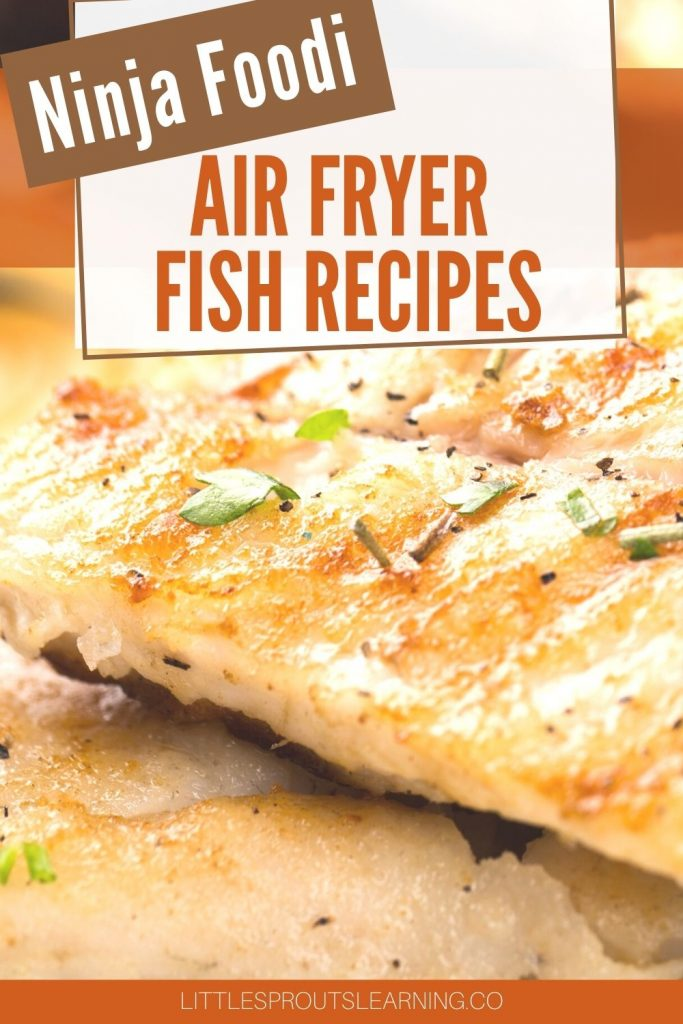 air fryer fish fillets browned and topped with herbs stacked on a plate