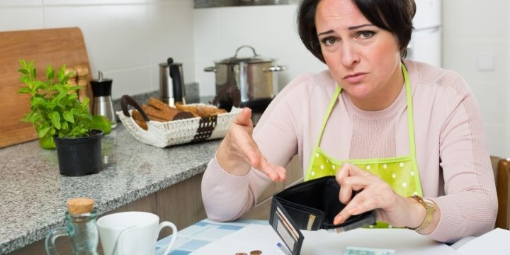 woman pointing at empty wallet