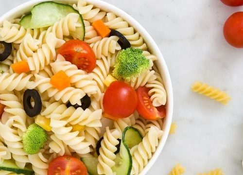 cold pasta salad with veggies on a board