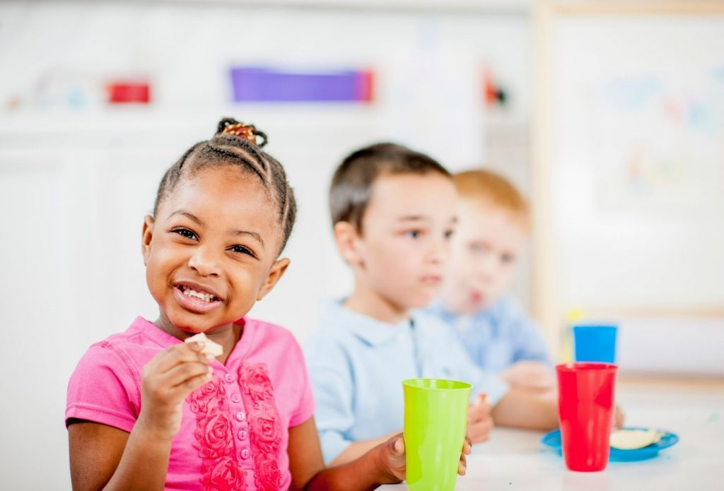 kids at a table eating daycare snacks