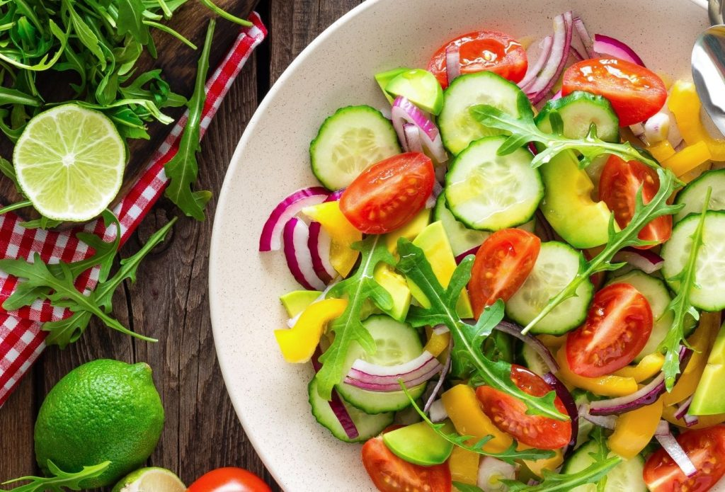 Cucumber salad with tomatoes and arugula