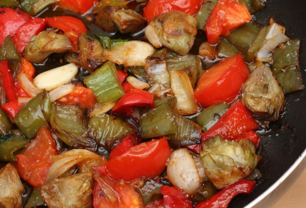 Sauted vegetables in a skillet for meatless monday